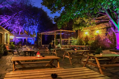 the Pomfret Arms garden at night